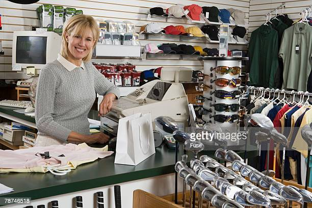 Store Clerk in a Golf Shop