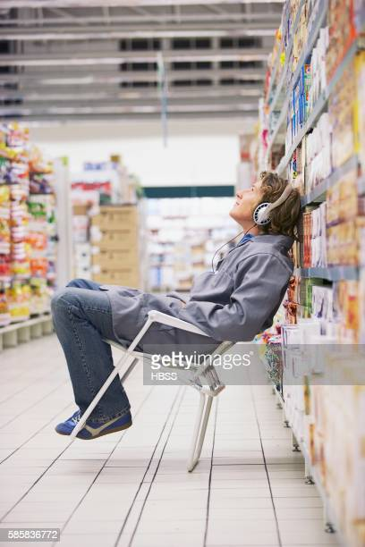 Store clerk leaning on chair