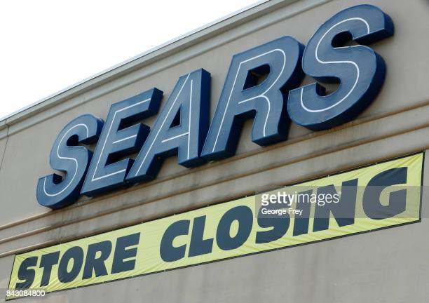 A store closing sign hangs under the Sears sign on September 5 2017 in Provo Utah The Sears store which has been open for decades in Provo is one of...