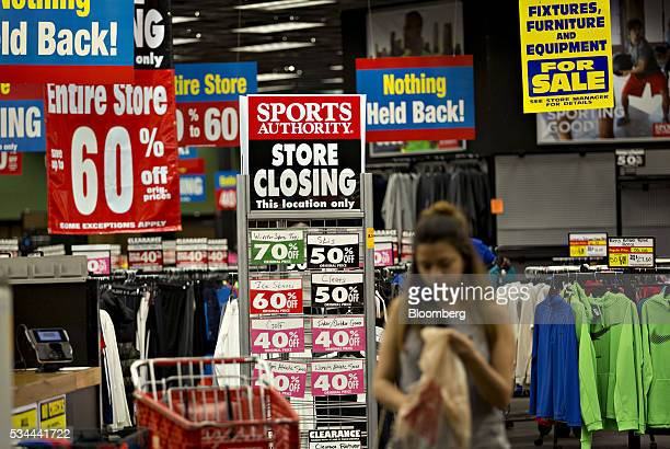 A 'Store Closing' sign stands as a customer shops inside a Sports Authority Inc store in Matteson Illinois US on Tuesday May 24 2016 A judge...