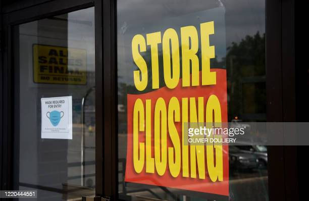 A store displays a sign before closing down permanently as more businesses feel the effects of stayathome orders amid the coronavirus pandemic on...