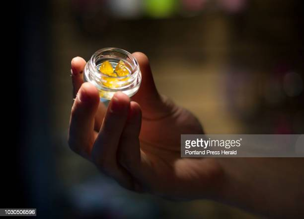 A store employee holds some dabs which are concentrated doses of cannabis at Ganja Candy Factory in Portland on Thursday