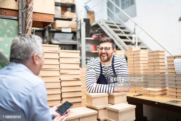 store employees checking storage and products - dedication stock pictures, royalty-free photos & images