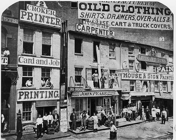Store fronts along numbers 2 and 5 Hudson Street, Manhattan,...