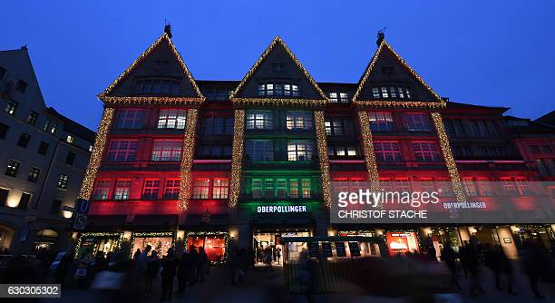 A store house in the city of Munich southern Germany is illuminated with Christmas lights on the evening of December 20 four days before Christmas /...