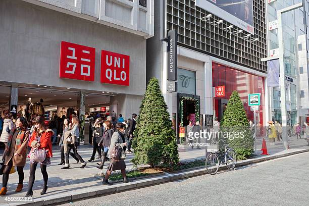 uniqlo store in tokyo, japan - chuo dori street stock photos and pictures
