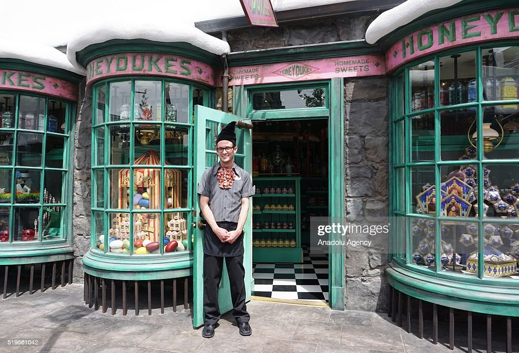 Store keeper poses in front of a shop at Hogsmeade village in 'Wizarding World of Harry Potter' theme park at Universal Studios Hollywood, in Los Angeles, USA on April 6, 2016.