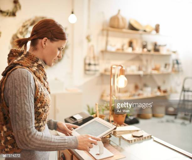 store management made easy with modern tech - checkers stock photos and pictures