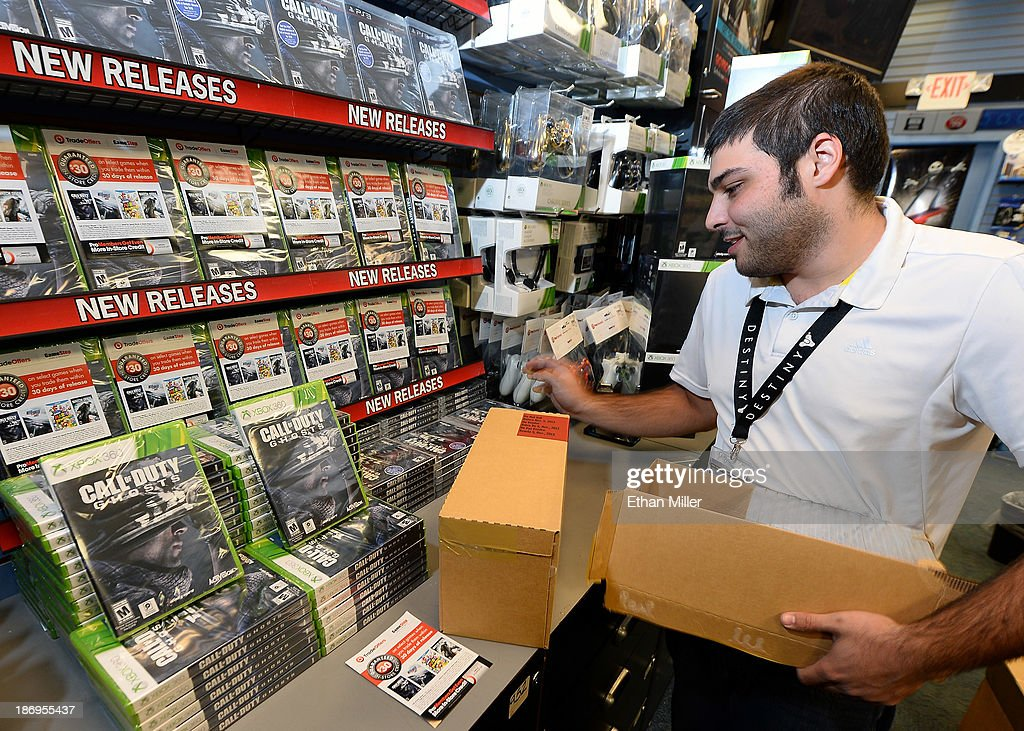 Store manager Brandon Khan stacks copies of 'Call of Duty: Ghosts' during a launch event for the highly anticipated video game at a GameStop Corp. store on November 4, 2013 in North Las Vegas, Nevada. Video game publisher Activision released the 10th installment in the 'Call of Duty' franchise at midnight on November 5.