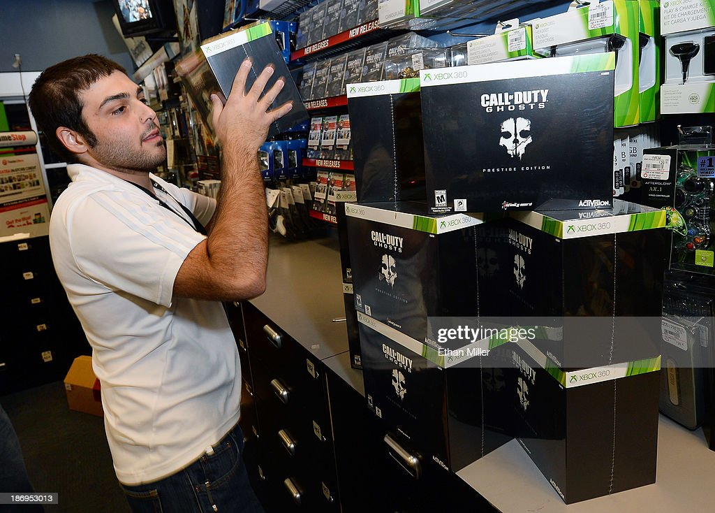 Store manager Brandon Khan stacks prestige edition copies of 'Call of Duty: Ghosts' for the Xbox 360 during a launch event for the highly anticipated video game at a GameStop Corp. store on November 4, 2013 in North Las Vegas, Nevada. Video game publisher Activision released the 10th installment in the 'Call of Duty' franchise at midnight on November 5.