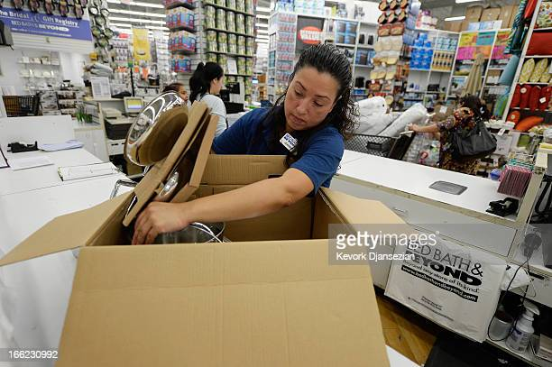 Store managerJeannie Archila packs up a cookware at a Bed Bath & Beyond store on April 10, 2013 in Los Angeles, California. The home goods retailer...