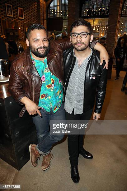 Store Merchandiser Tommy Blackadar and Manager Walter Reed attend A Tribute To Rock Roll hosted by Schott NYC Featuring Photographs from Photographer...