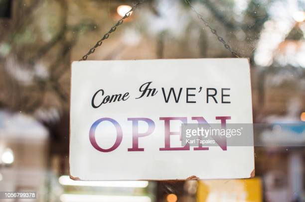 store open sign hanging on the window - store opening stock pictures, royalty-free photos & images