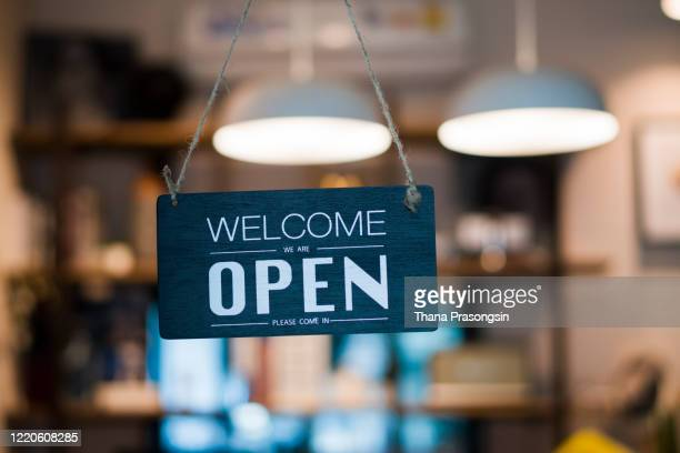 store open sign hanging on the window - opening event stock pictures, royalty-free photos & images