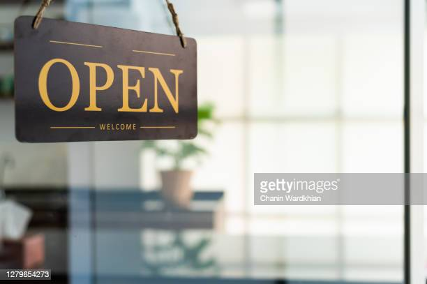 store open sign hanging on the window - new stock pictures, royalty-free photos & images