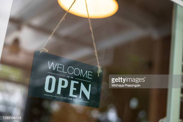 store open sign hanging on the window - capital region stock pictures, royalty-free photos & images
