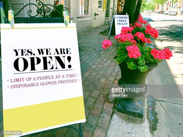 store open signage in age of covid-19 - reopening stock pictures, royalty-free photos & images