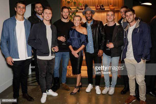 Store owner Anna Baird with Josh Gibson and Hawthorn players attend the Bared Footwear VIP Launch Party on June 7 2017 in Melbourne Australia