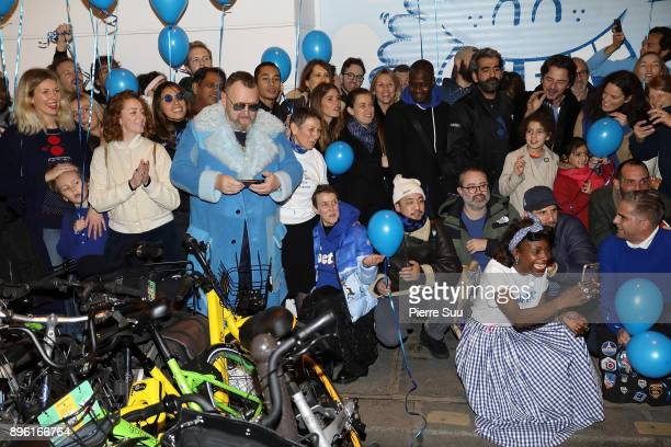 Store owner Colette Rousseaux her daughter Sarah Andelman and their friends pose for a souvenir picture outside the store minutes before the famous...