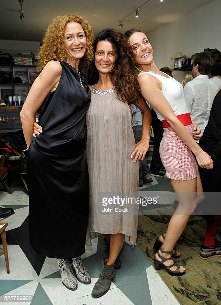 Store owner Cristina Guidetti and guests attend the Fiorentini Baker and Deborah Baker celebration of the publication of Holz Hollywood with...