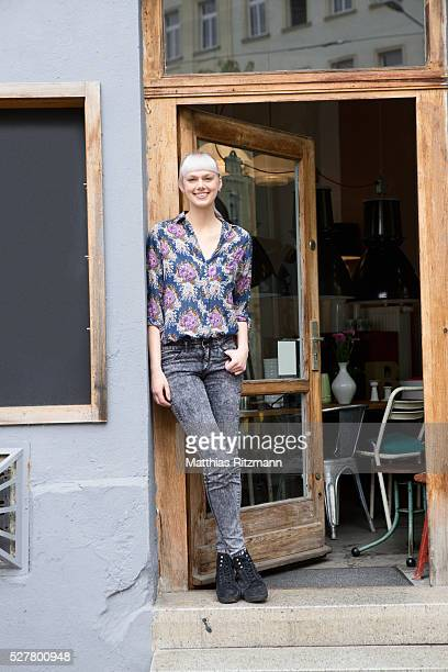 store owner in front of shop - open blouse stock photos and pictures