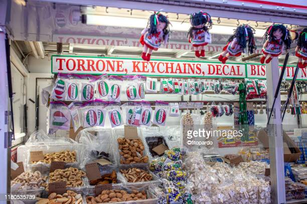 store selling memorabilia souvenirs and sweets at the feast of san gennaro in little italy new york city - candy dolls fotografías e imágenes de stock