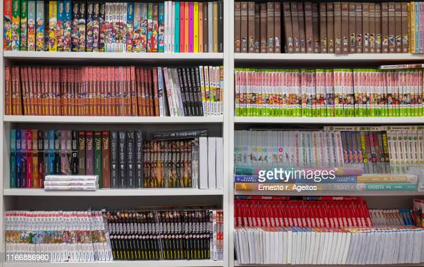 store shelves filled with manga comic books - comic book stock pictures, royalty-free photos & images