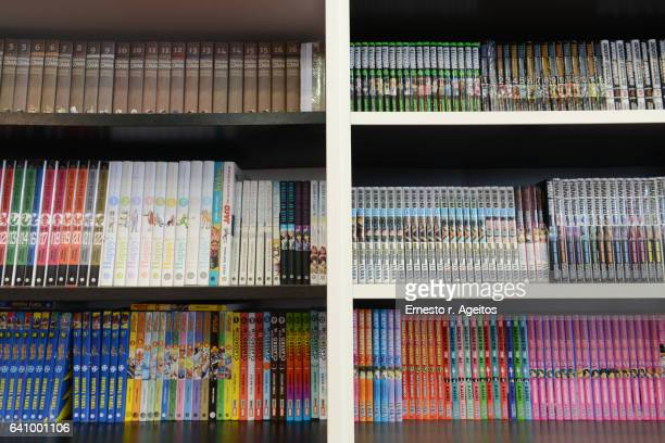 store shelves filled with manga comic books - anime stock photos and pictures