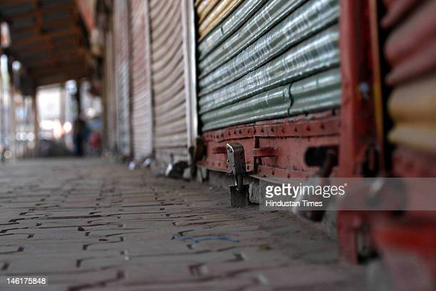 Store shutters sit locked during shuts down on June 11 2012 in Srinagar India shops educational institutions and business establishments remained...