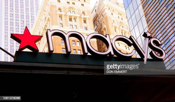 A store sign hangs on the Macy's store at Manhattan's Herald Square January 11 2019 in New York Macy's boasts being the world's largest store