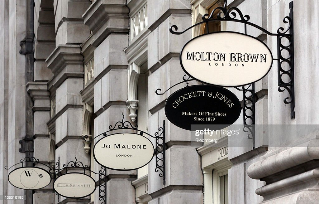 Store Signs Hang Outside The Royal Exchange Luxury Shopping And Dining  Arcade In London, U.K.