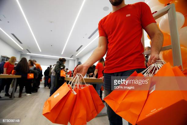 XANADú ARROYOMOLINOS MADRID SPAIN A store staff seen with many gift prepared for the first customers The company Xiaomi inaugurates its first store...