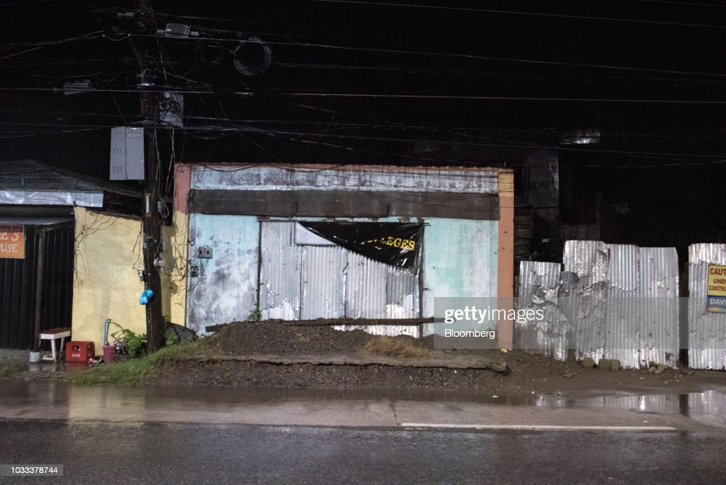 A store stands closed ahead of Typhoon Mangkhut in Tuguegarao city, Cagayan, in the Philippines, on Friday, Sept. 14, 2018. Super Typhoon Mangkhut is expected to threaten Chinas Guangdong coastline, and Hong Kong, with a possible direct strike that may cause as much as $120 billion in damage and economic losses. Photographer: Carlo Gabuco/Bloomberg via Getty Images