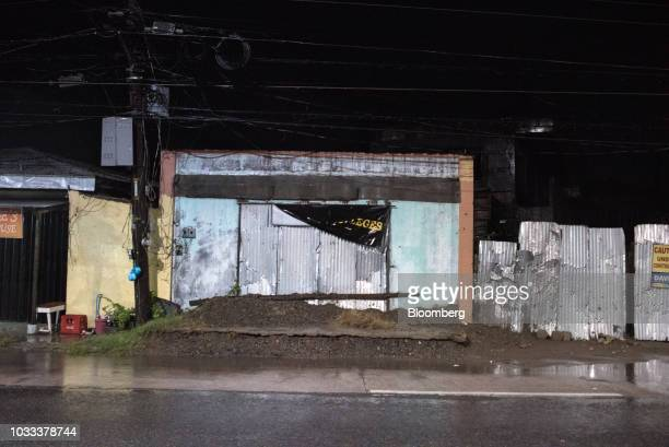 A store stands closed ahead of Typhoon Mangkhut in Tuguegarao city Cagayan in the Philippines on Friday Sept 14 2018 Super Typhoon Mangkhut is...