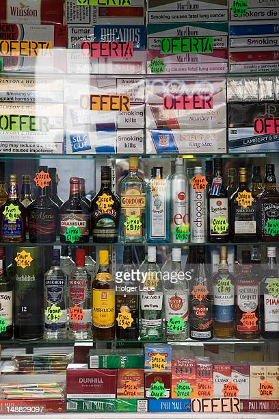 Store window with duty free liquor and cigarettes for sale.