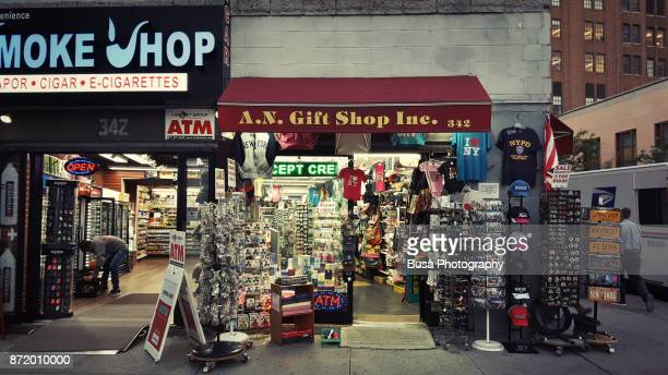 store windows at canal street, between chinatown and tribeca, in lower manhattan, new york city - gift shop stock photos and pictures