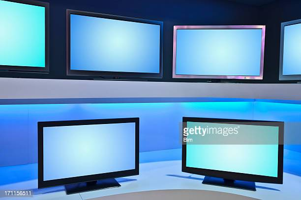tv store with rows of ldc tvs - lcd tv stock photos and pictures