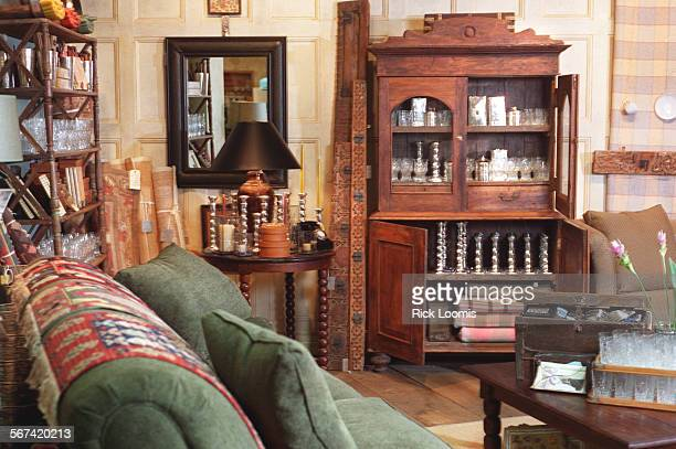 LSstore#30924RL–KODAK–Newport Beach–One of Anthropologie's rooms in their Fashion Island store The centerpiece an Indian cupboard with arched doors...