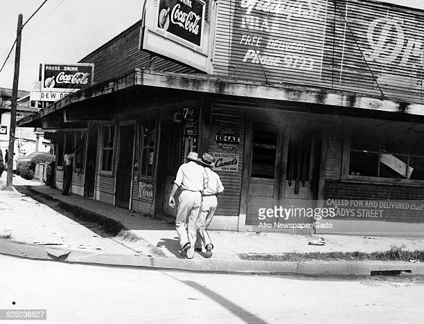 Storefront during the aftermath of a riot Baltimore Maryland June 26 1943