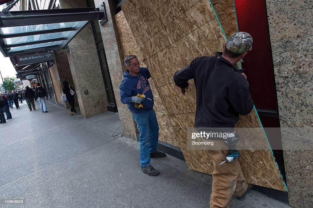 A storefront is covered during an Occupy Seattle May Day rally and anti-capitalist march in Seattle, Washington, U.S., on Tuesday, May 1, 2012. Occupy Wall Street demonstrators took to the streets in May Day protests from New York to California, picketing banks in Oakland with helicopters overhead and sending a singing 'Guitarmy' to Manhattan's Union Square. Photographer: Stuart Isett/Bloomberg via Getty Images