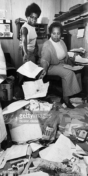 Storefront Learning Center director Thelma Burns right and associate dir Bessie Washington left throw away files damaged in a breakin at the...