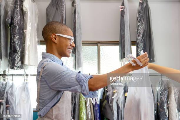 storefront of a dry‐cleaner's shop - dry cleaned stock pictures, royalty-free photos & images