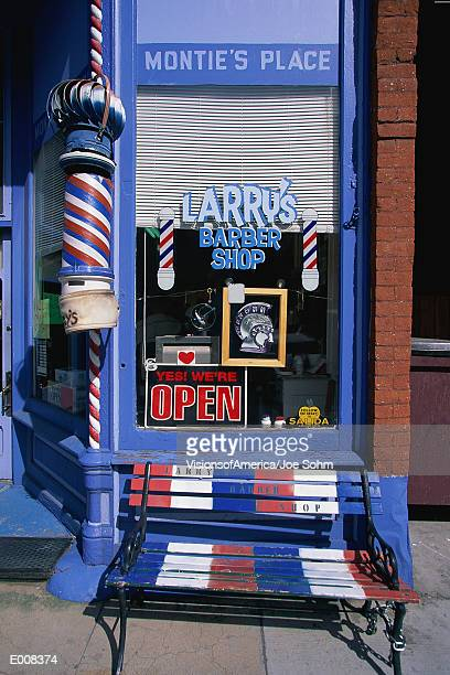 storefront of larry's barber shop, co - barber pole stock photos and pictures