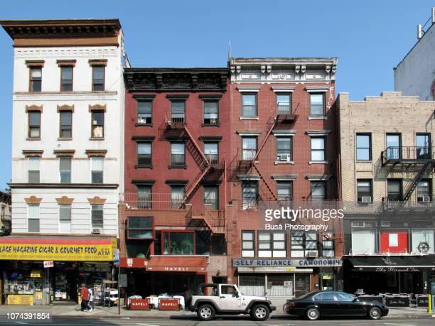 storefronts in the east village in new york city - east village stock-fotos und bilder