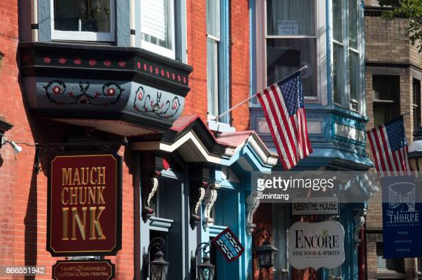 storefronts on broadway street in downtown jim thorpe - jim thorpe pennsylvania stock photos and pictures