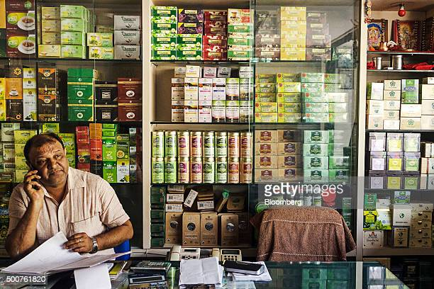 A storekeeper speaks on the phone at a tea store in Siliguri West Bengal India on Tuesday Dec 8 2015 India has a $48 billion premium tea market...