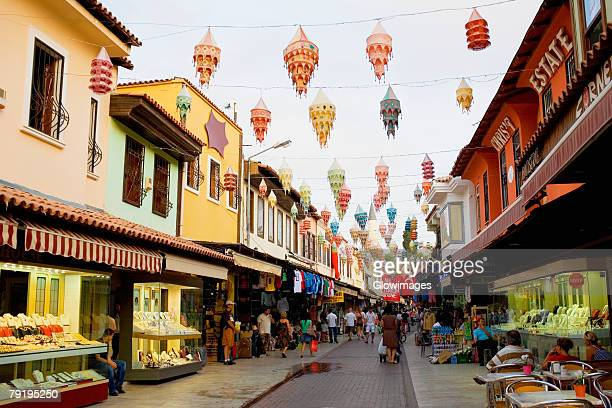 stores along a street in a city, ephesus, turkey - izmir stock pictures, royalty-free photos & images