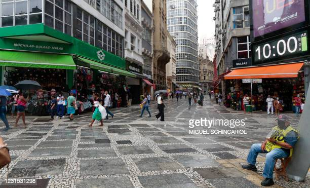 Stores are seen open before non-essential services must close at midnight and until March 20 in the state of Sao Paulo, amid the novel coronavirus...