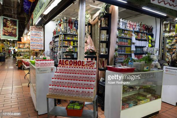Stores diversify their products to offer alcohol and other protective and disinfectant products inside the usually crowded Mercado Juárez on March 26...