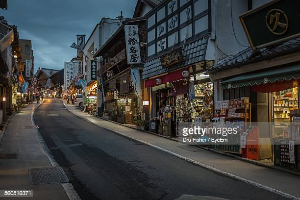 stores in city street during dusk - narita stock photos and pictures